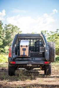 50-litre camping fridge in SUV boot load bay